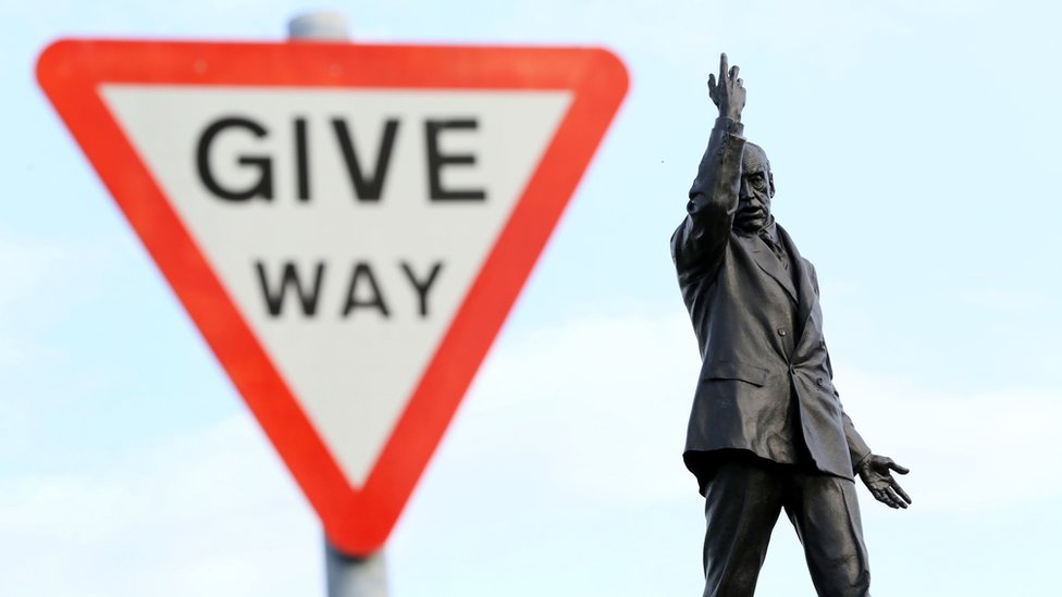 A 'Give way' sign next to the statue of former unionist leader Lord Carson at Stormont