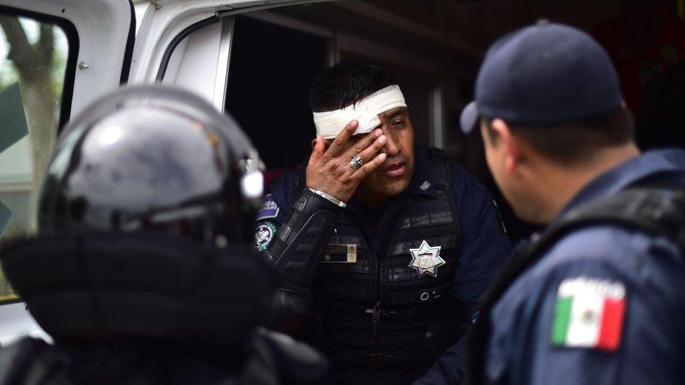 Policia mexicano herido.