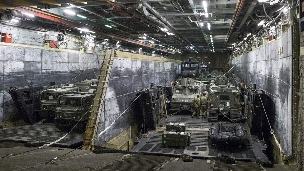 Armoured vehicles and trucks aboard HMS Bulwark as it docks at the port in the Israeli coastal city of Haifa