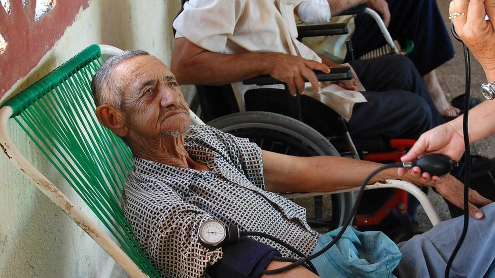 An elderly man has his blood pressure taken in Havana
