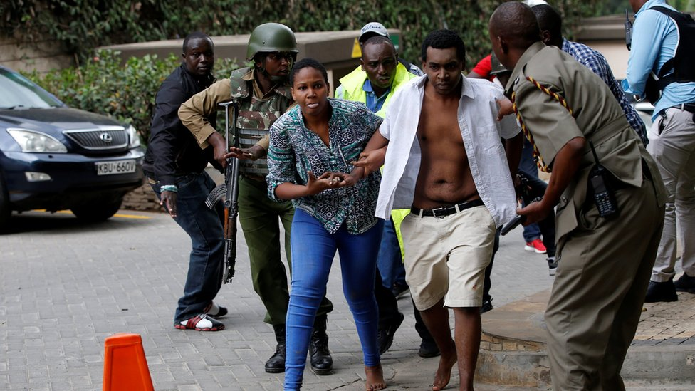 People are evacuated at the scene at the Dusit hotel compound in Nairobi, Kenya