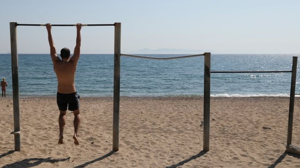 A man exercises on a beach, following the coronavirus disease (COVID-19) outbreak, in Athens, Greece, April 28, 2020