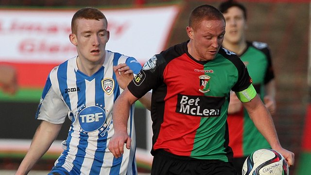 Coleraine's Rodney Brown attempts to win the ball from Glentoran's Stephen McAlorum