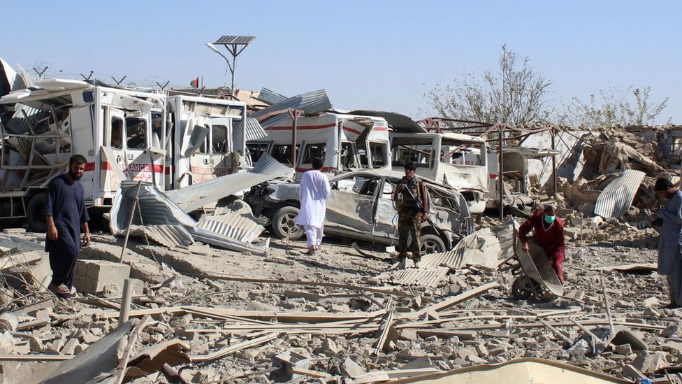 Afghan security forces investigate the site where a Taliban car bomb detonated in Zabul province on September 19, 2019