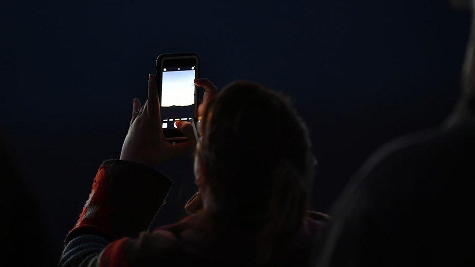 Man taking pictures in Burnsville, USA