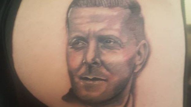 'A reminder to think before you speak' - fan gets boss Monk's face tattooed on backside