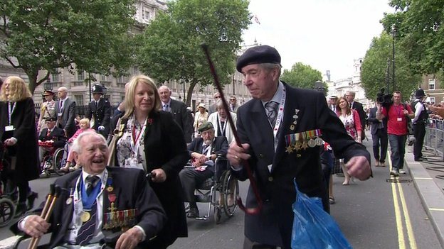 Man dances as veterans make their way down Whitehall