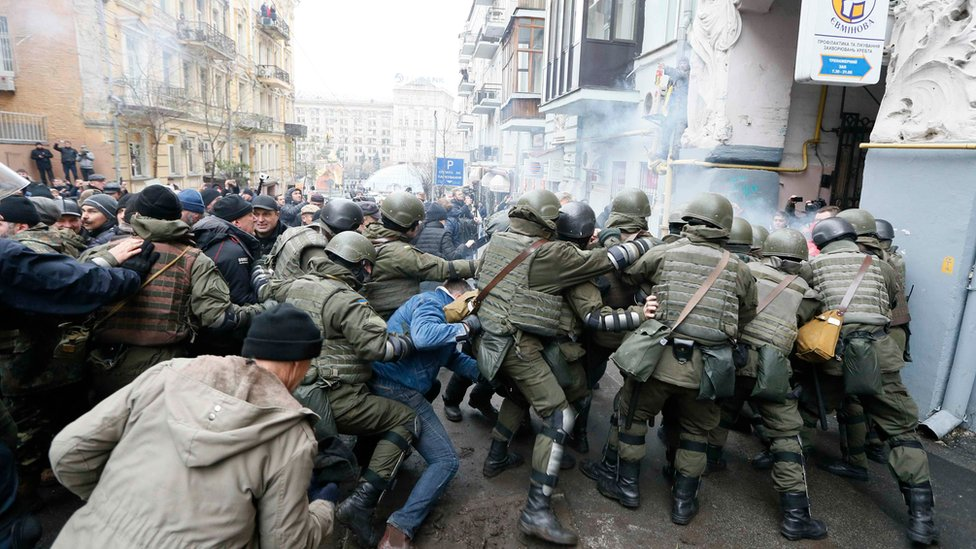 National Guard officers clash with supporters of Georgian former President Mikheil Saakashvili