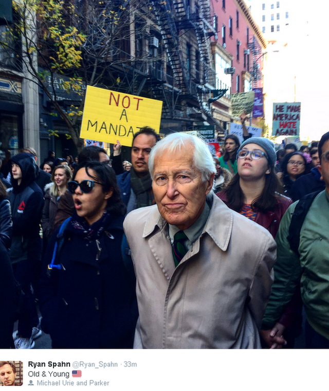 Tweeted image, protesters fill a street, with anti-Trump placards