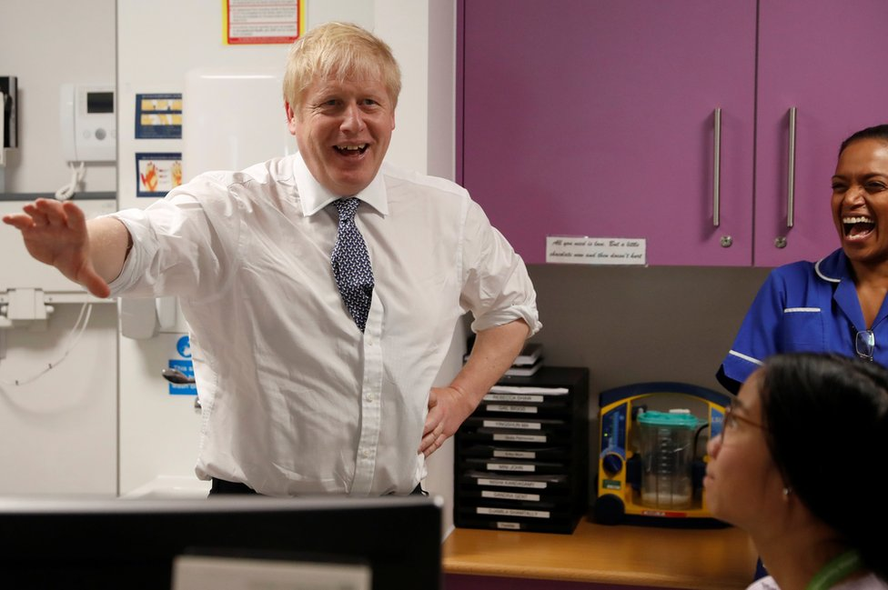 British Prime Minister Boris Johnson greets and speaks to nurses at National Institute for Health Research at the Cambridge Clinical Research Facility