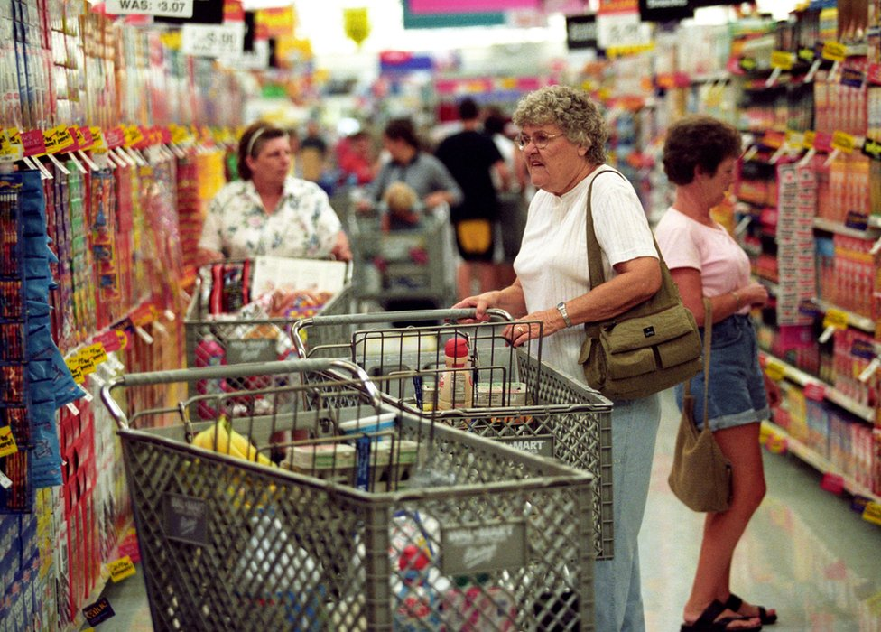 Customers shop during the grand opening of a Wal-Mart Supercenter August 14, 2002 in Athens, Ohio.