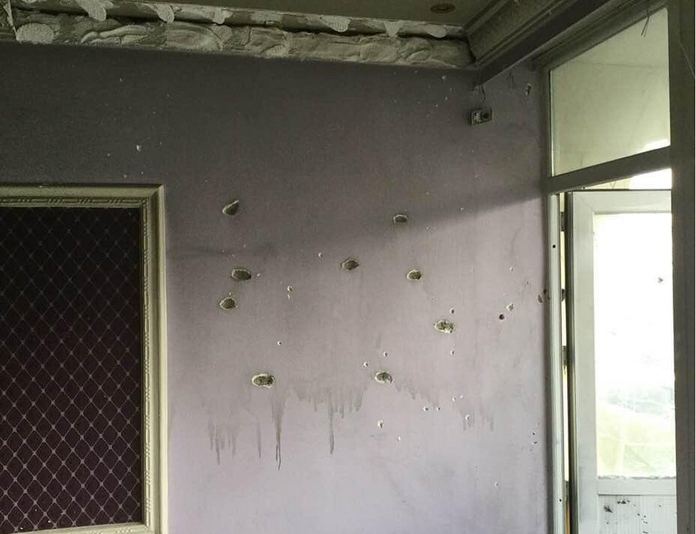 Bullet holes in the walls of a room at the Intercontinental Hotel