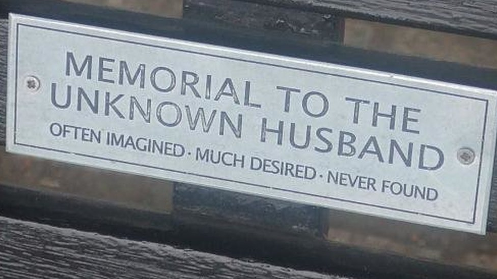 """Bench dedication: """"Memorial to the unknown husband. Often imagined. Much desired. Never found."""""""