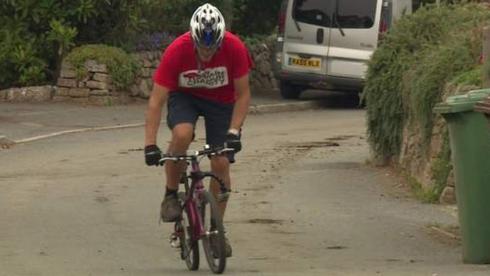 Father riding late daughter's tiny bike 200 miles for charity