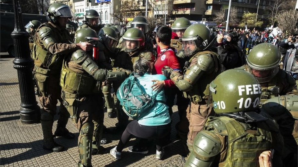 Police officers arrest a protester during a demonstration against the Chilean Government's education policies, in Santiago, Chile, 03 July 2019, after five weeks of strike of education professionals