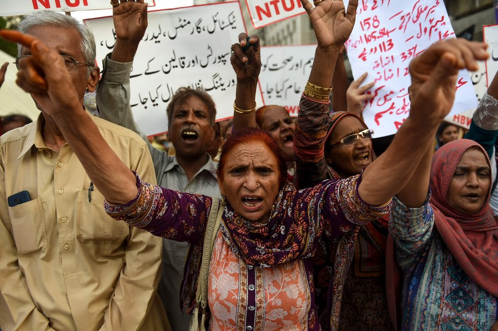 Supporters of Home Based Women Workers Federation (HBWWF) shout slogans against the 2019 national budget and the International Monetary Fund (IMF) during a protest in Karachi on July 6, 2019, after prices were hiked