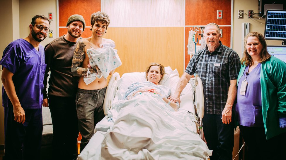 The Eledge and Dougherty family stand with newborn baby Uma.