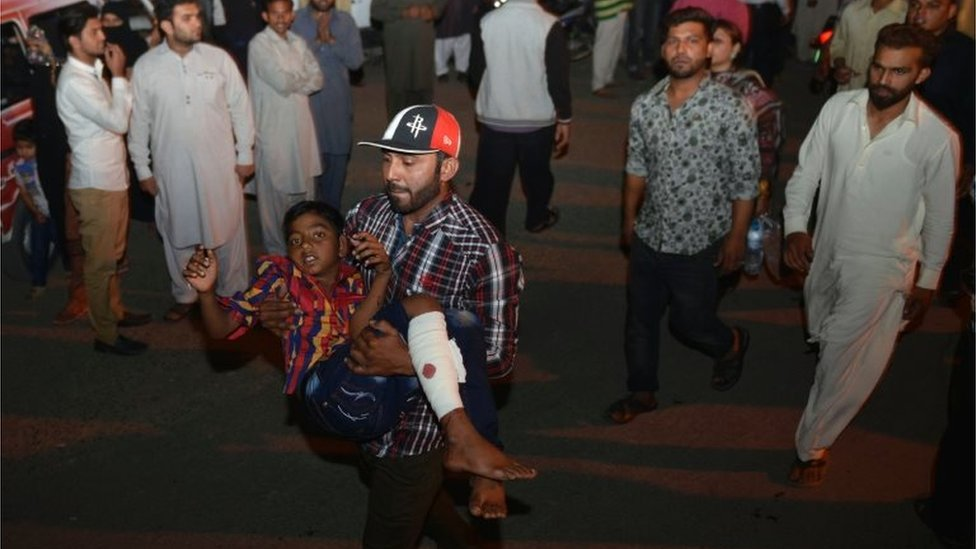 An injured boy is carried to hospital in Lahore