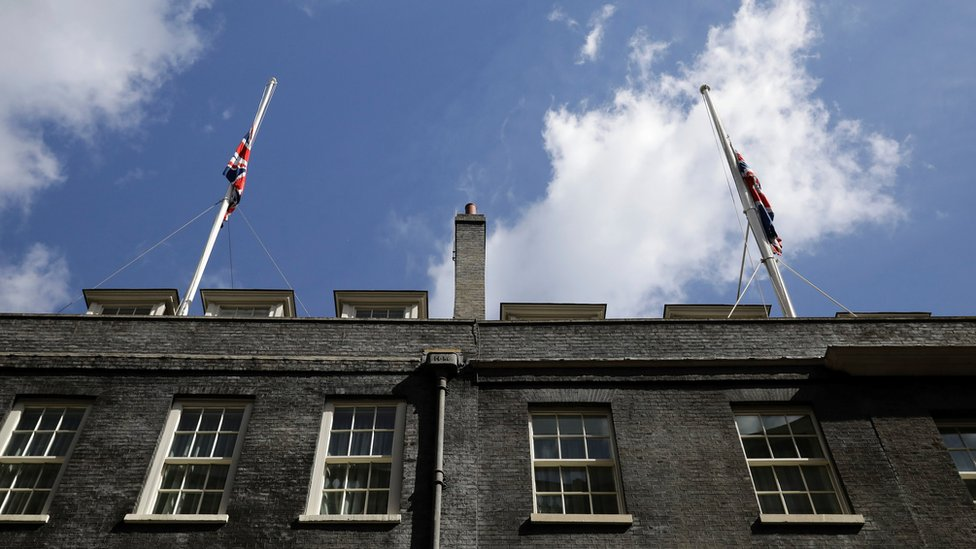 Union flags at half-mast on the roof of Downing Street