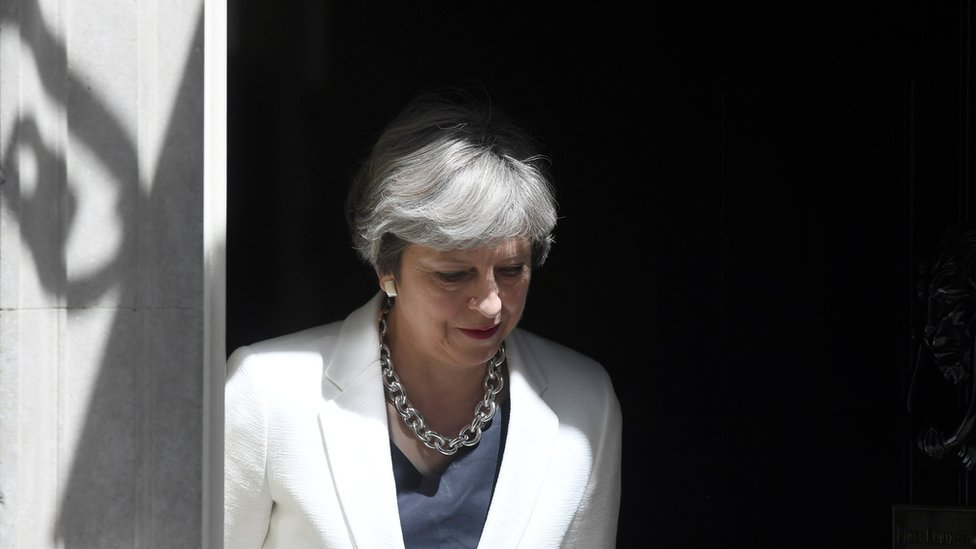 Britain's Prime Minister, Theresa May, waits on the doorstep of no 10 to greet the Prime Minister of Estonia