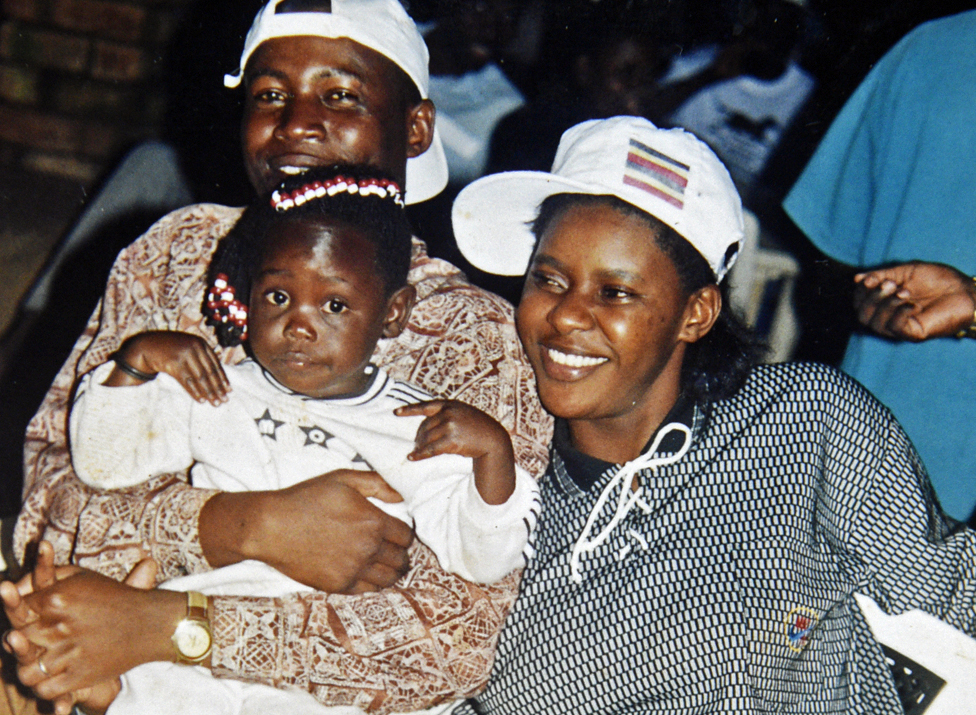 A young Susan Kigula with partner Constantine and young daughter.