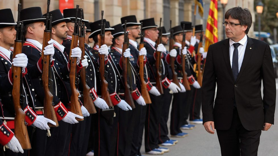 President of the Catalan regional government Carles Puigdemont inspects the Mossos d'Esquadra - the Catalonian police force - before attending an award ceremony on 10 September 2017 in Barcelona