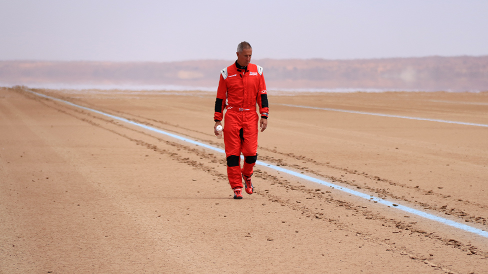 Andy Green inspects the track