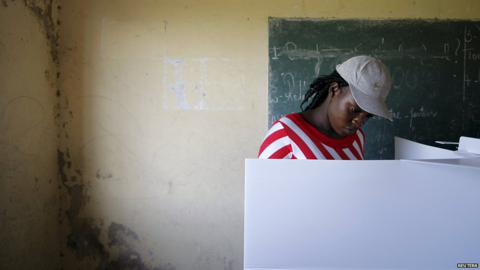 A woman votes in Haiti's parliamentary elections