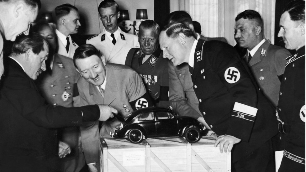 Adolf Hitler inspects a VW model car