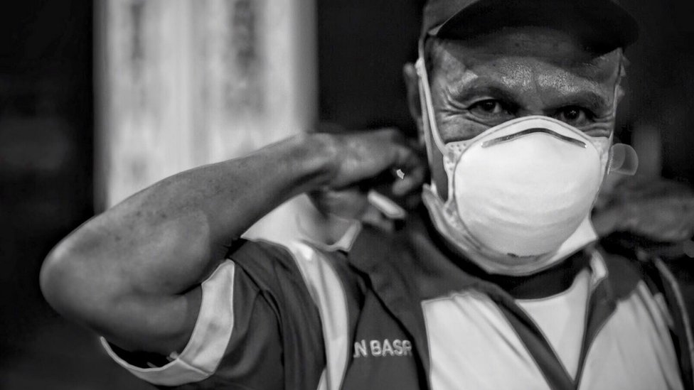 A man in Indonesia's central Kalimantan province wears an N95 face mask