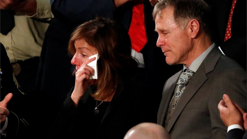 """American student Otto Warmbier""""s parents Fred and Cindy Warmbier cry as U.S. President Donald Trump talks about the death of their son after his arrest in North Korea during the State of the Union address"""