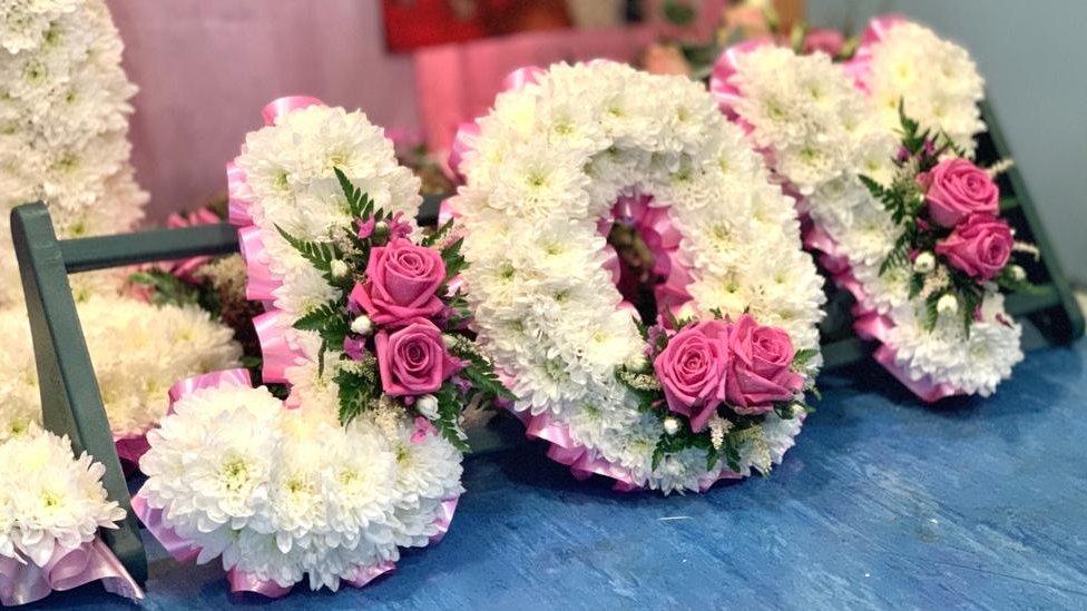 Flowers spelling out Joy