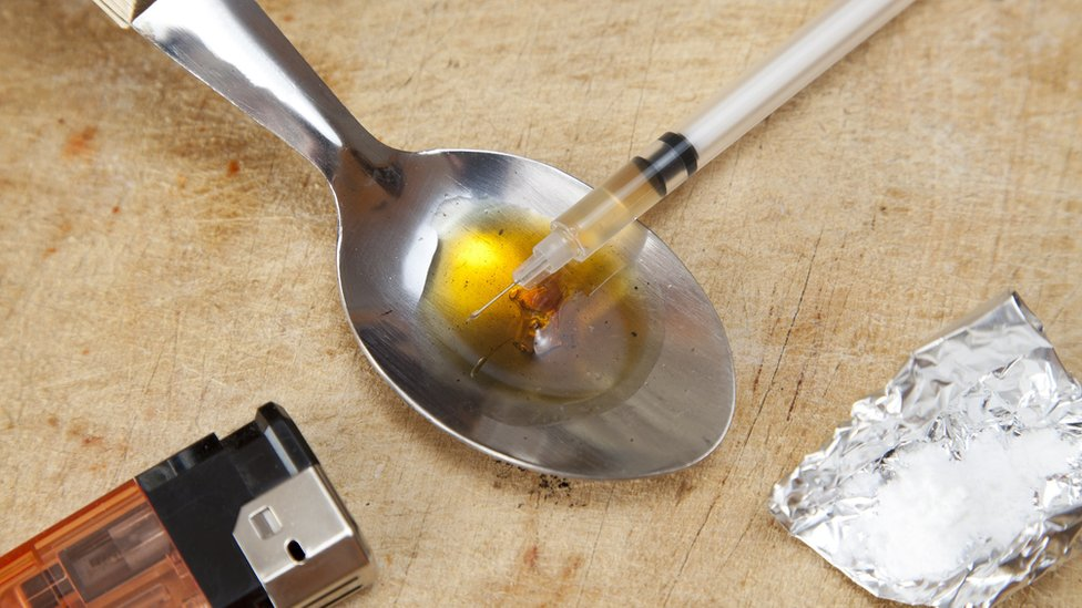Drug addiction concept shot with a spoon, lighter, and a needle
