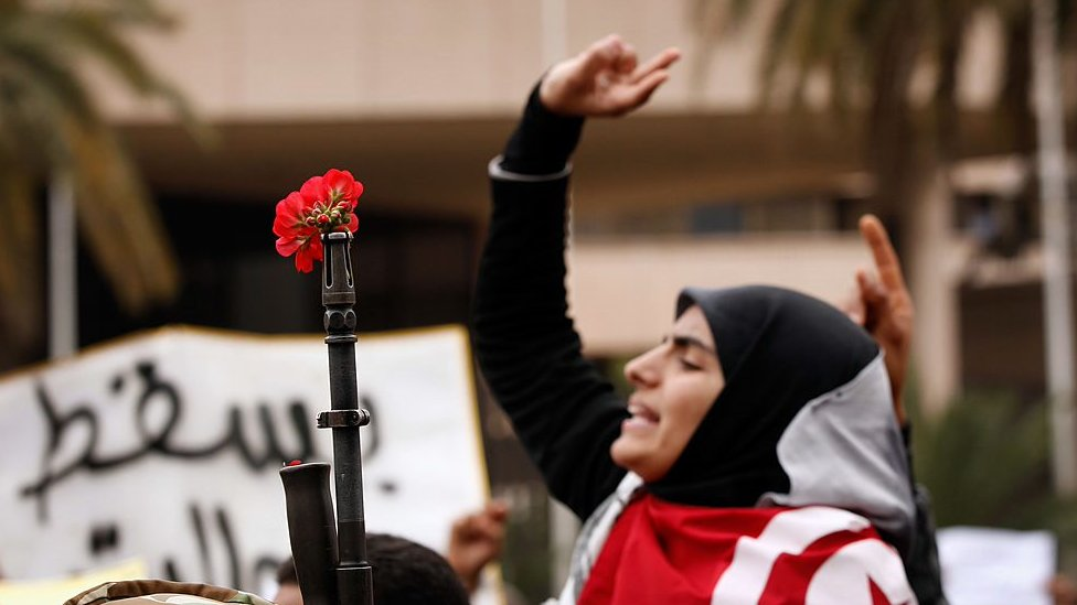 A woman takes part in an Arab Spring protest in Tunisia in 2011