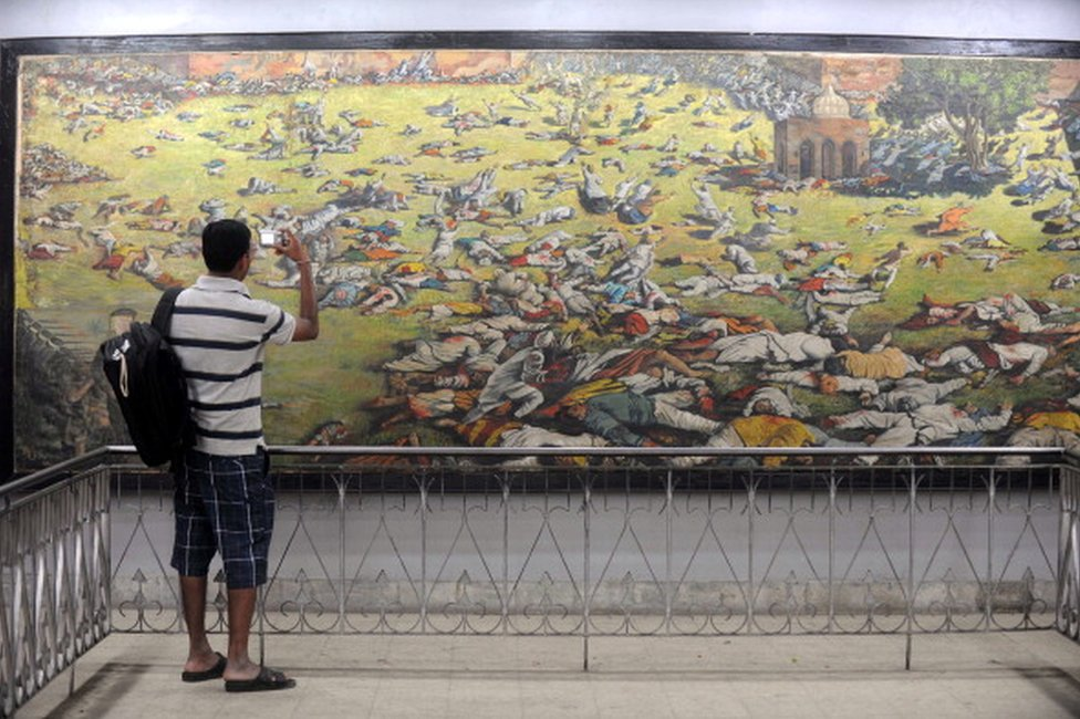 An Indian man takes a photograph of a painting depicting the Jallianwala Bagh massacre in Amritsar on April 12, 2011. The Amritsar massacre, also known as the Jallianwala Bagh Massacre, took place on April 13, 1919 when British Indian Army soldiers on the direct orders of their British officers opened fire on an unarmed gathering killing at least 379 men, women and children, according to official records. AFP PHOTO /NARINDER NANU (Photo credit should read NARINDER NANU/AFP/Getty Images)