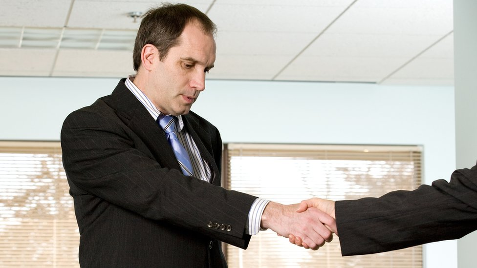 Sad man shaking hands