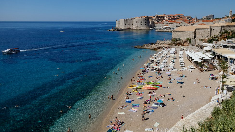 People enjoying time on a beach in Dubrovnik, Croatia