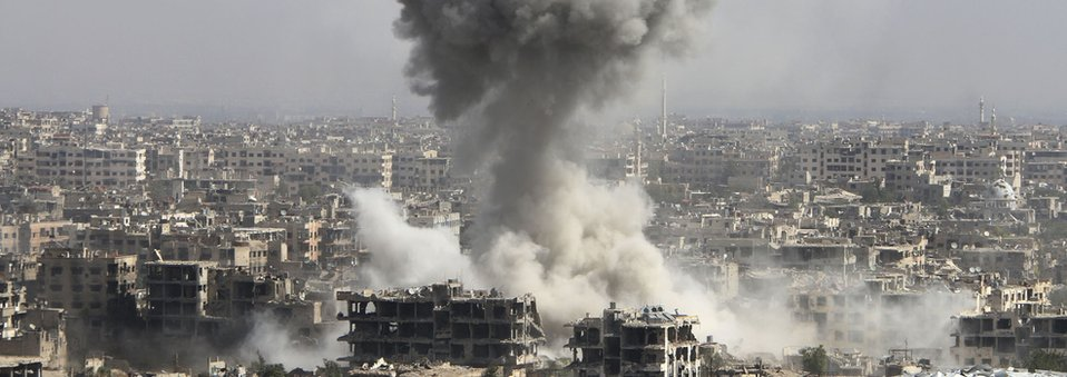 smoke rises after shelling by the Syrian army in Jobar, Damascus