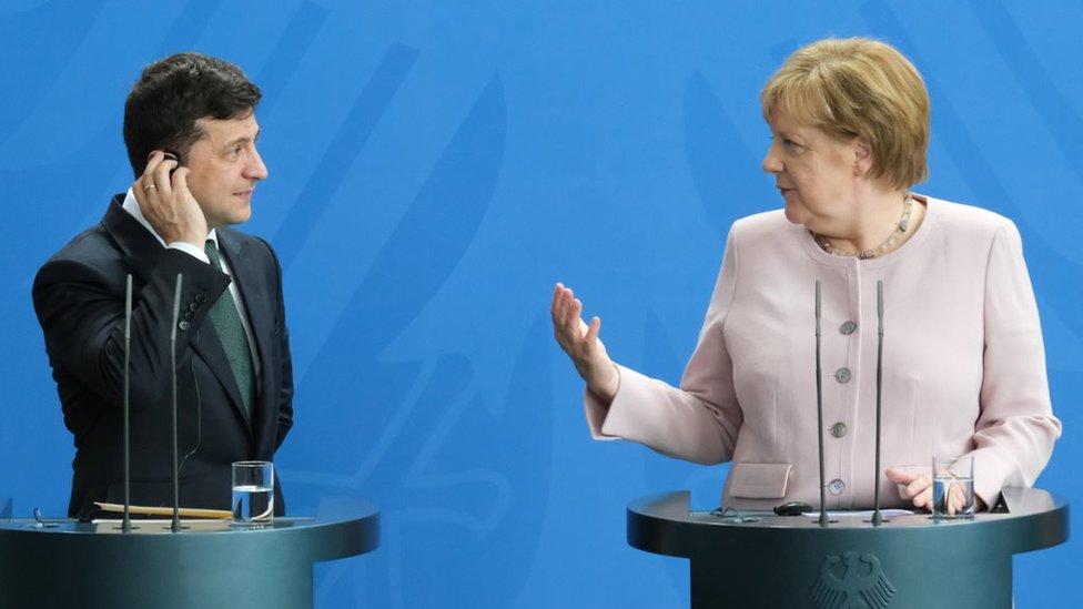 German Chancellor Angela Merkel and new Ukrainian President Volodymyr Zelensky speak to the media following talks at the Chancellery on June 18, 2019 in Berlin