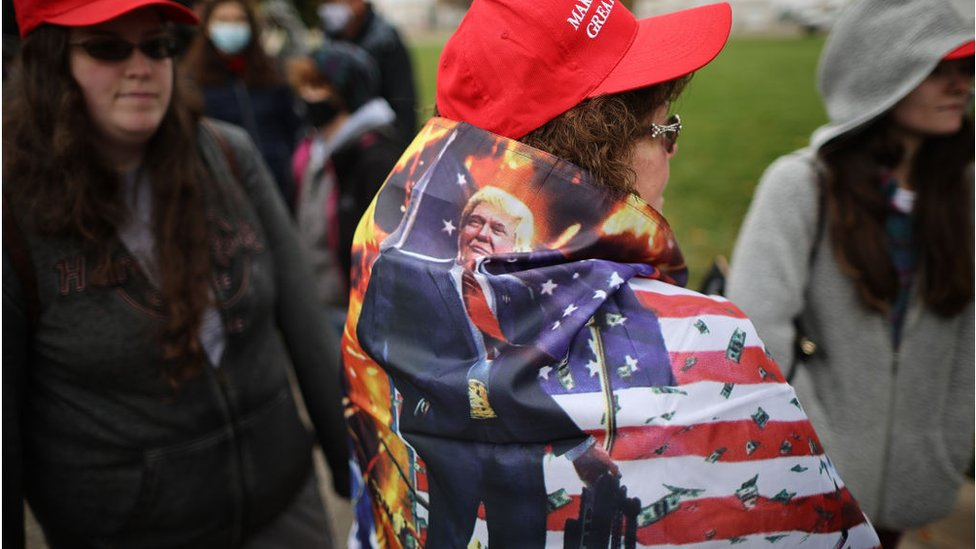 Thousands of supporters stand in line hoping to attend a campaign rally with U.S. President Donald Trump at Capital Region International Airport October 27, 2020 in Lansing, Michigan.