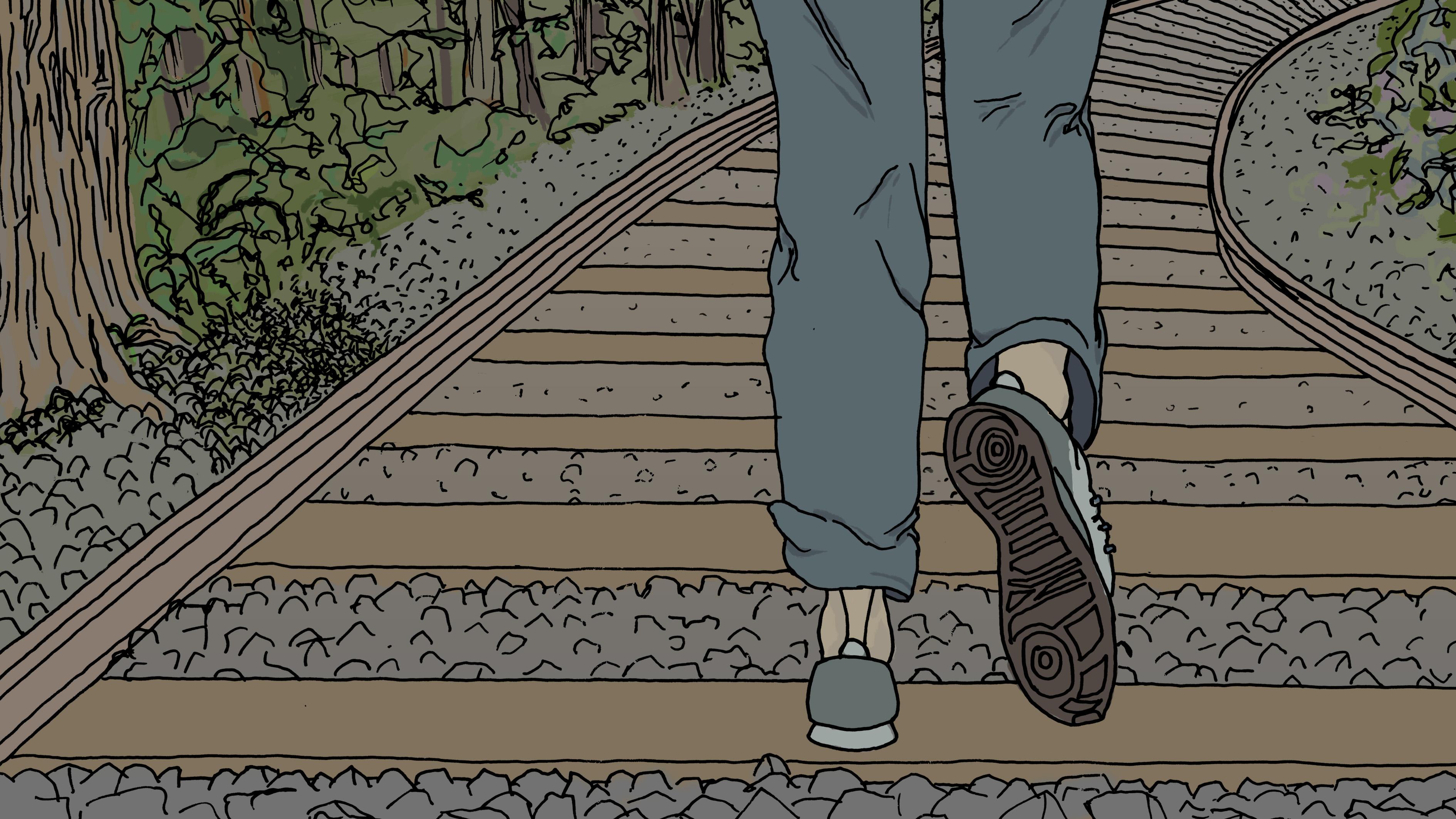 Boy running on railway line