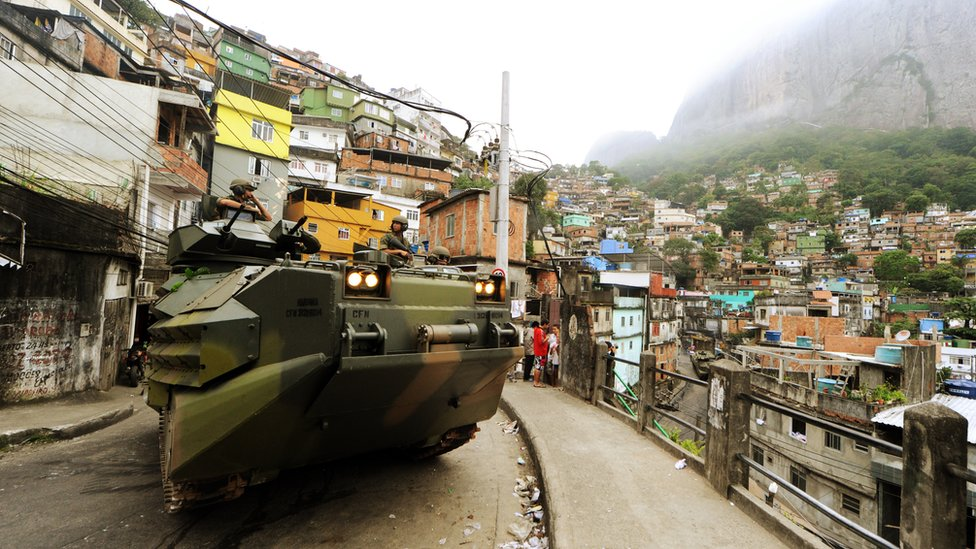 Brazilian marines entering Rio de Janeiro in 2011 to seize control of the city's largest favela