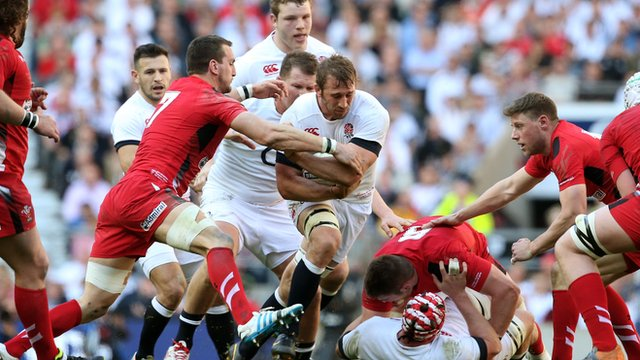 Chris Robshaw of England is tackled by Sam Warburton of Wales during the Six Nations match between England and Wales at Twickenham Stadium in 2014.