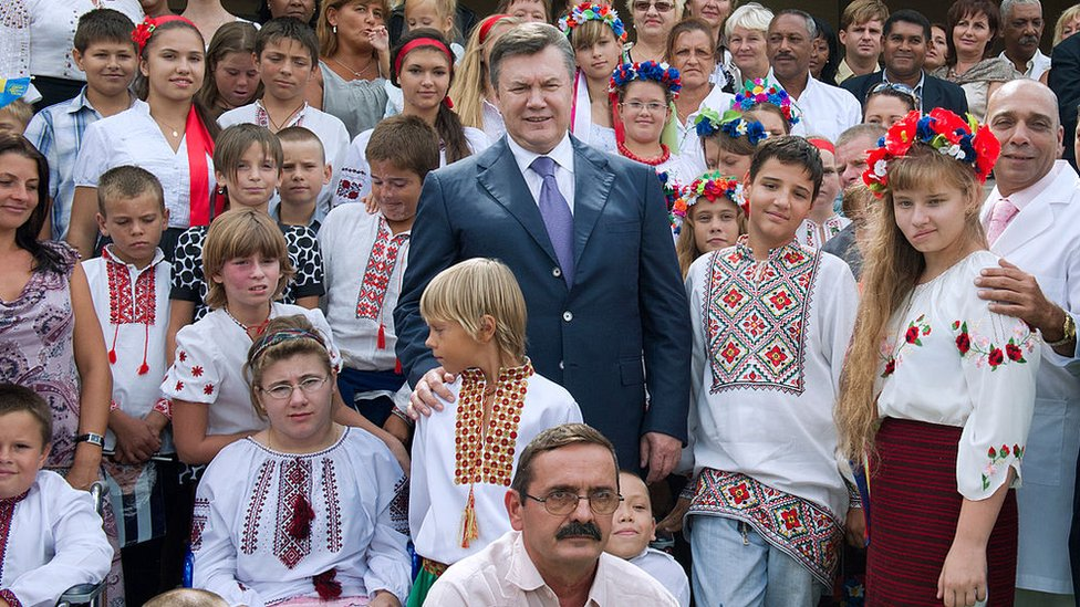 Ukraine's former president Victor Yanukovich poses with former patients of the Kids from Chernobyl programme