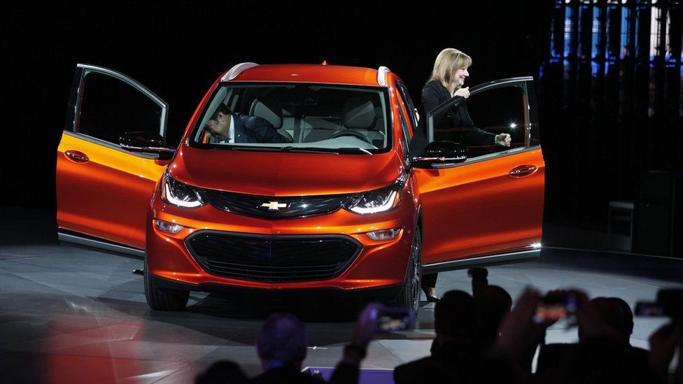 Mary Barra, Chairman and CEO of General Motors, and Mark Reuss, Executive Vice President of GM Global Product Development, reveal the Chevrolet Bolt EV at Detroit
