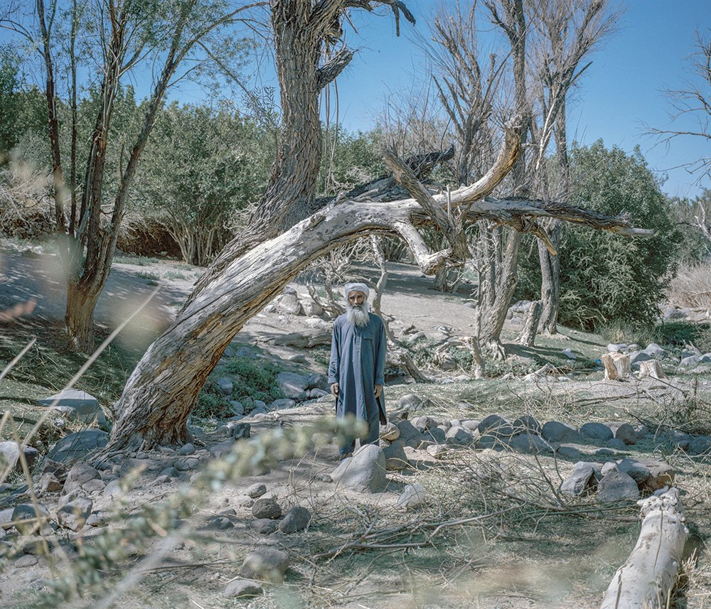 Abdullah, pictured near a fruit tree