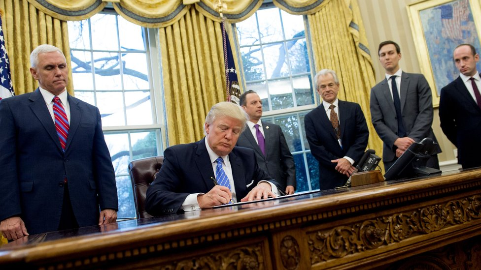 US President Donald Trump signing an abortion-related order in the Oval Office
