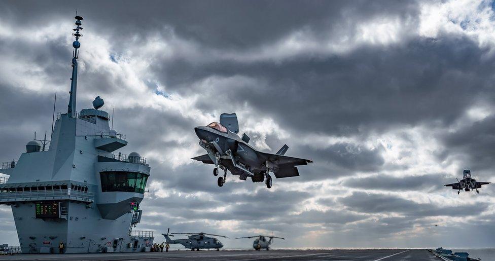 An F-35B Lightning jet landing on HMS Queen Elizabeth