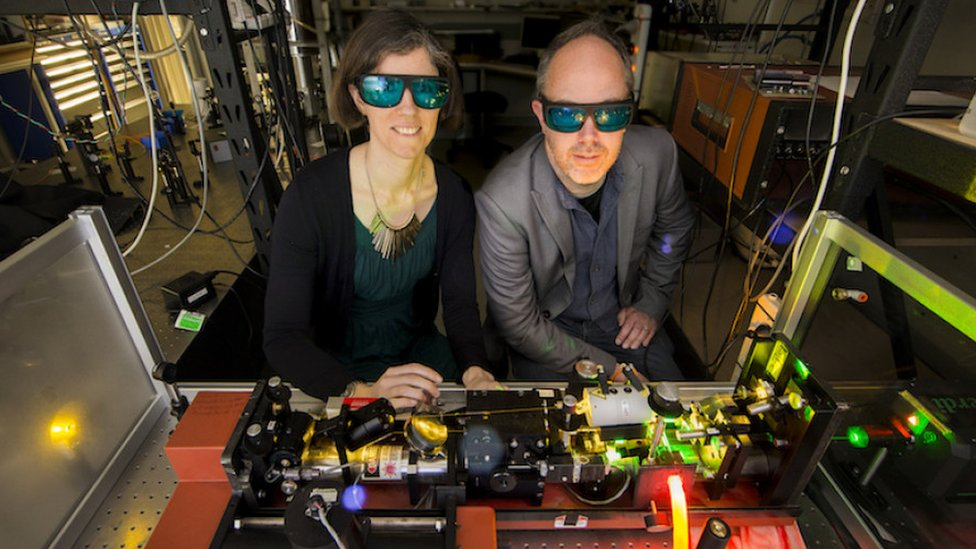 Dr Rose Ahlefeldt and Associate Professor Matthew Sellars operate a high-resolution dye laser to study rare earth crystals at ANU