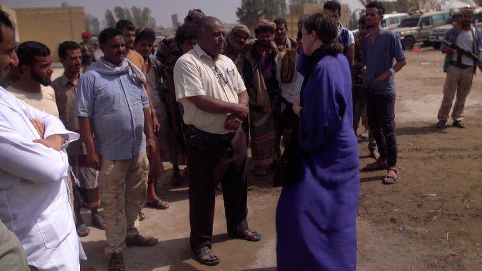 Lyse Doucet speaks to people outside a hospital in western Yemen